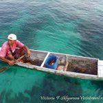 Рыбак в лодке, Национальный парк Комодо